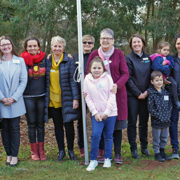 Photo of Aboriginal and Torres Strait Island women supported by Bass Coast community leaders following NAIDOC Week flag raising ceremony.
