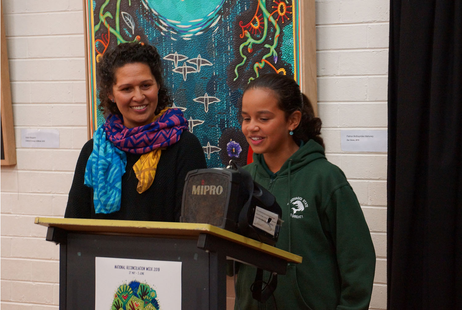 Arieta and Safina presenting artwork